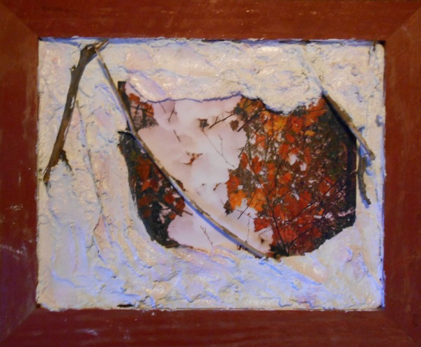 """October Surprise"", 2013. mixed media including plaster, photo, twigs, oils, 11"" x 14""."