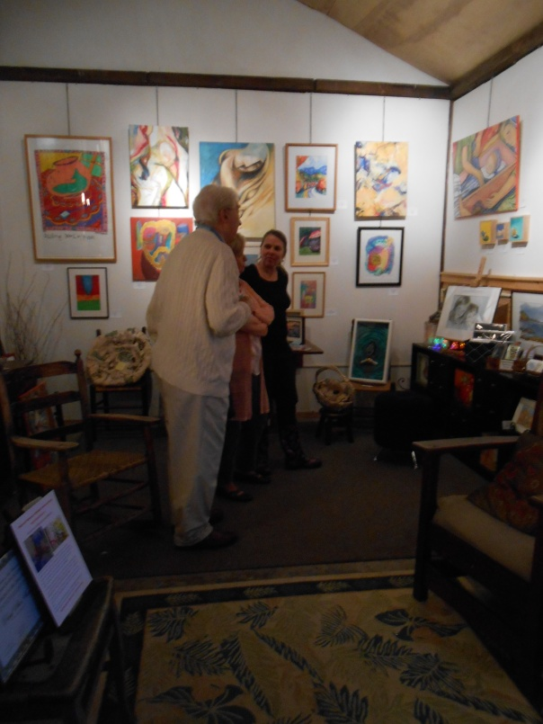Jean Coughlin discusses Blackbird Studios with a woman interested in joining.